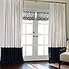 Oyster Linen with Navy Border with Custom Roman Shades in Schumacher Trells