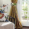 Anique Gold Custom Silk Drapery with Custom Tieback in Schumacher Trellis Midnight